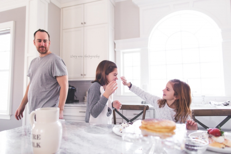 Natural light in home lifestyle family session with a gorgeous family making pancakes. www.stacymaephotography.com
